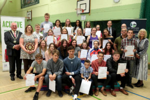 The award winners with Cllr Norman MacRae (far left) and Cllr Jeanette Baker (far right). Callum Smart is third left from the front.